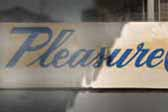 1955 Pleasure Craft vintage trailer has an original Pleasure Craft logo board in the window