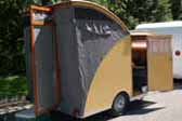 1956 CampMaster Teardrop trailer with wood sidea and canvas rear pop-top