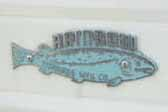 1956 Rainbow vintage trailer still has an original fish cast logo badge