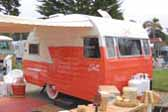 Beautifully restored Vintage Shasta 1400 travel trailer in pastel orange