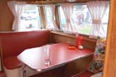 Welcoming Dining area in 1956 Shasta model 1400 trailer