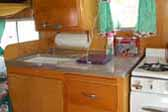 Photo of 1956 Shasta 1500 trailer showing beautiful birch cabinetry