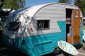Sharp 1956 Shasta 1400 Trailer painted bright blue and white