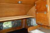 Photo shows bedroom and ceiling hammock in 1956 Shasta 1400 Travel Trailer