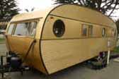 Distinctive factory correct gold anodized aluminum siding on a 1957 Airfloat Cruiser vintage trailer