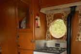 Gas wood stove and restored gas oven/stove unit in beautiful 1957 Airfloat Cruiser trailer