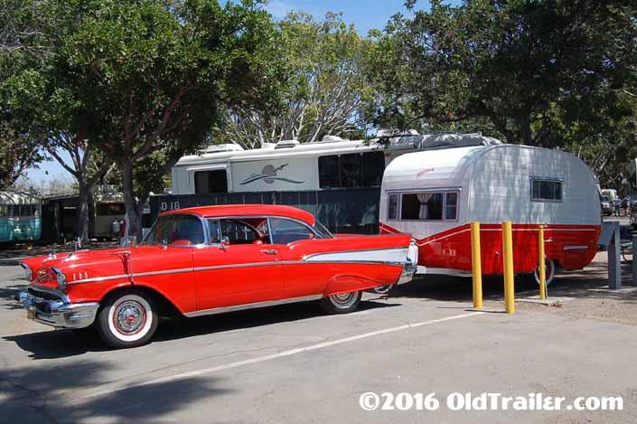 This vintage towing rig is a 1957 chevy bel air 2 door hard top pulling a vintage starfire trailer