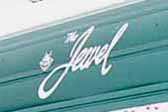 Jewel logo graphic on the front end of a 1957 Jewel vintage trailer