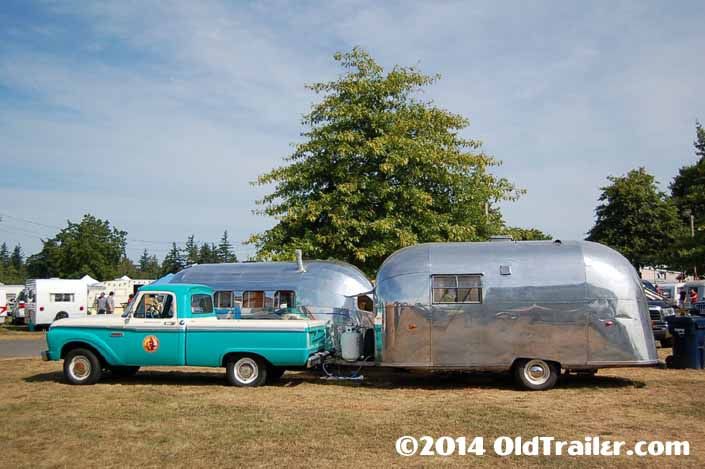 This vintage towing rig is a ford f250 pickup truck pulling a vintage 1958 airstream trailer