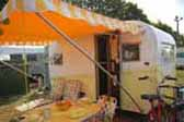 1958 Aloha canned ham trailer with matching yellow and white striped side awning