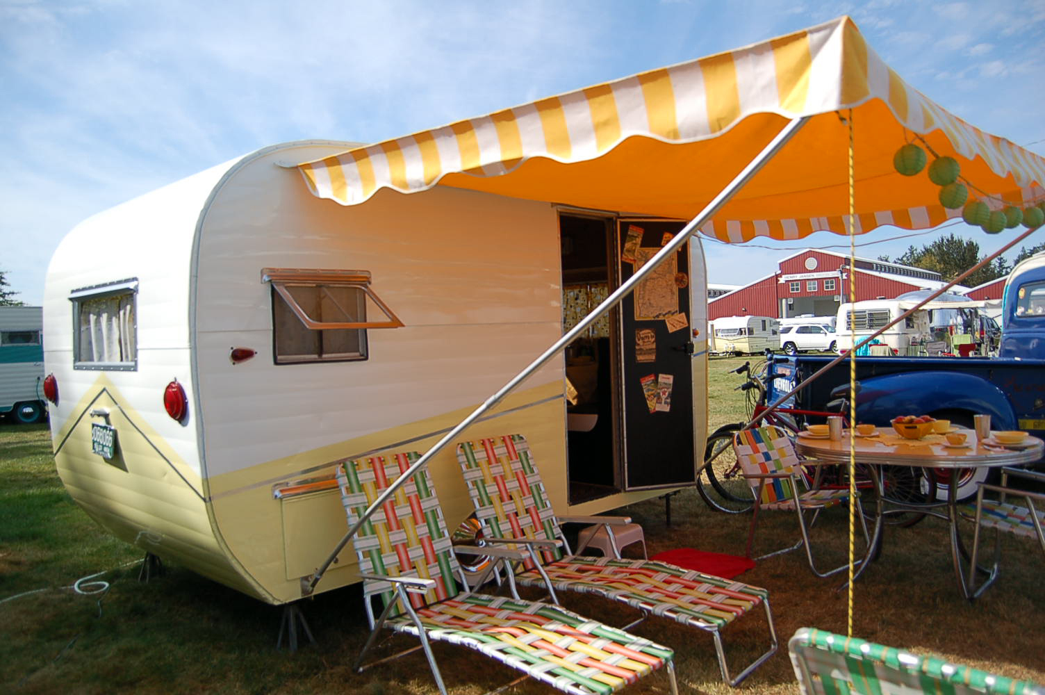 Restored 1958 Aloha Travel Trailer Painted Yellow And White With Matching  Yellow Chaise Lounge Chairs