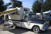 Photo of a restored 1959 chevy apache fleetside pickup truck with a vintage alaskan expanding top camper shell