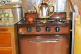 Vintage Princess gas stove with bronze finish, in 1959 Shasta Airflyte Trailer