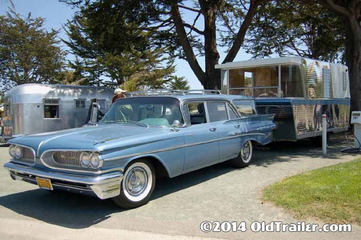 This vintage towing rig is a 1959 pontiac catalina wagon pulling a 1960 holiday house travel trailer