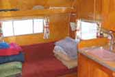 Photo of warm bedroom plywood paneling in 1960 Shasta Airflyte trailer