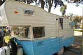 Vintage 1961 Shasta Astrodome Trailer painted light blue and white colors