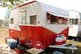 Fixed exterior awning over front windows on vintage 1962 Aloha 15 ft travel trailer
