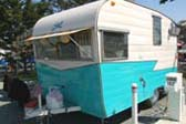 Cool Sunbrella Striped Awning on Dining Window of 1962 Shasta Trailer