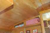 Original ceiling cabinets in dining area of 1962 Shasta Compact Trailer