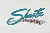 Vintage 1962 Shasta trailer has a very shrap blue reproduction logo decal on the side