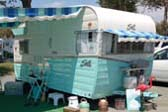 Classic 1962 Shasta Airflyte Travel Trailer With Striped Side and Window Awnings