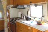 Comfortable bathroom off kitchen area in 1963 Airstream Flying Cloud trailer