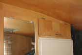 Original birch cabinets and plywood paneling in 1963 Shasta Trailer