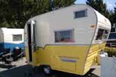 Photo of a beautifully restored Aladdin travel trailer.  This great toawable trailer is the compact Genie model, the smallest in the Aladdin model line