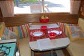 Great example of the dining table and seating bolsters in a restored vintage Aladdin travel trailer