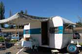 Photo shows a great looking side awning on a beautifully restored Aladdin travel trailer