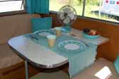 Very nicely decorated dining area in a fully restored Aladdin vintage trailer