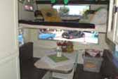 Photo shows sleeping loft over dining area in 1964 Aloha trailer cab-over model