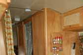 Beautiful woodwork around bathroom door in 1965 Airstream Tradewind trailer
