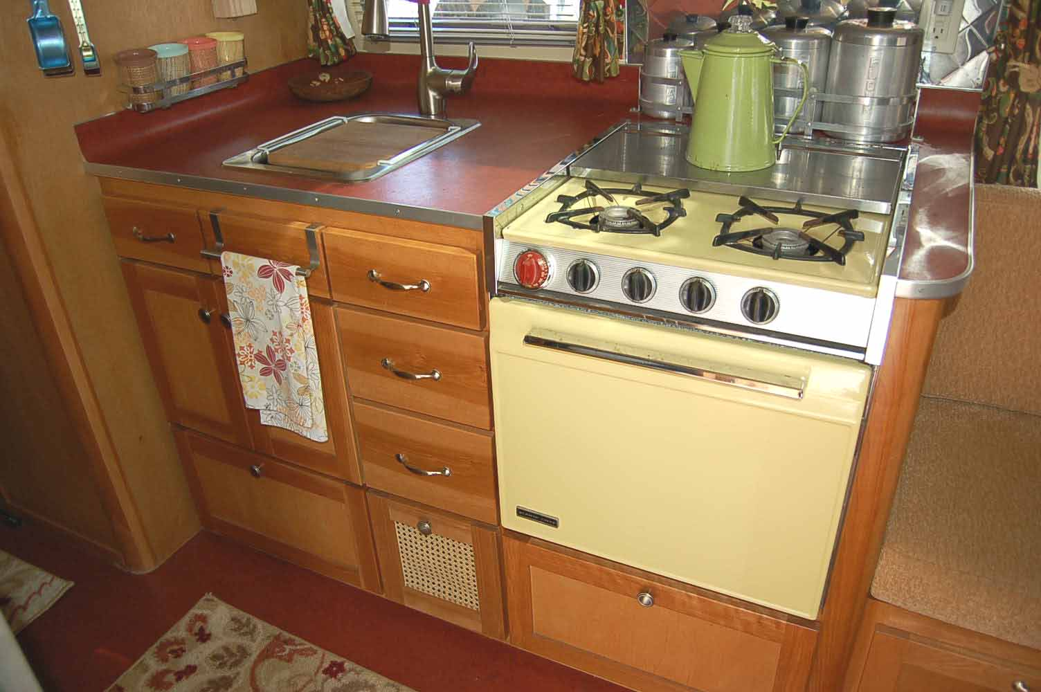 Photo Shows Restored 1965 Airstream Tradewind Trailer With Classic Yellow  Gas Range And Oven