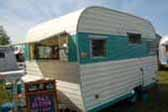 Beautifully restored vintage 1965 Aloha travel trailer with fiberglass awning window shade panel over front windows