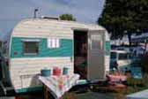 Nicely restored 1965 Aloha travel trailer and 1958 Edsel 2 door wagon in matching turquoise and white paint colors