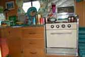 Picture shows restored oven and kitchen countertop cabinet in vintage 1965 Aloha trailer