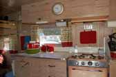 Photo shows the cabinets and wood work in the galley area of an Aladdin Magic Carpet trailer