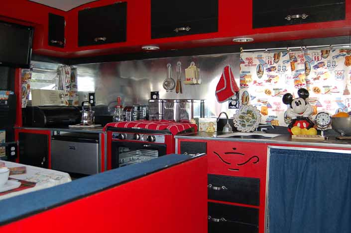 Photo shows the huge countertop and kitchen area in a vintage Aladdin Sultan's Castle Trailer