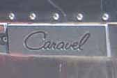 Cast aluminum Caravel logo plate on the side of a 1969 Airstream Caravel travel trailer