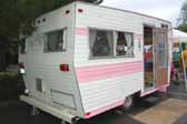 Rear view of pink and white 1969 Aladdin vintage trailer