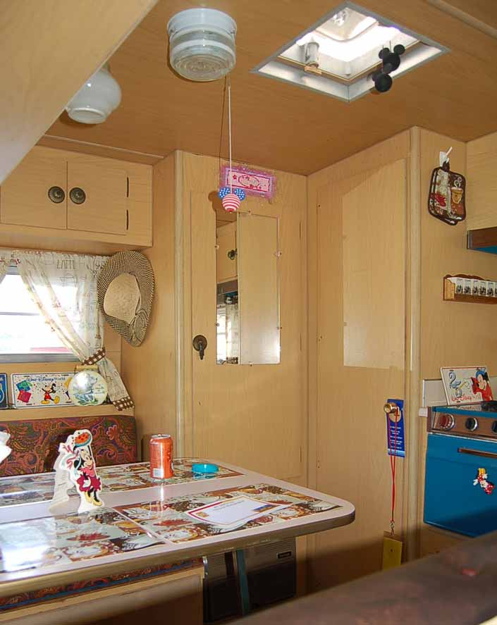 The Dining table and kitchen area in a vintage Aladdin Trailer