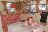 1969 Shasta Starflyte Travel Trailer with beautiful pink and white decorations in dining area