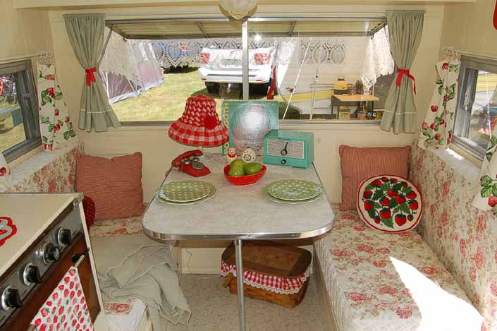 Beautifully restored and decorated dining area in a vintage Aladdin Travel Trailer