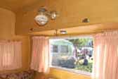 Picture shows very original dining area in a vintage Aloha travel trailer