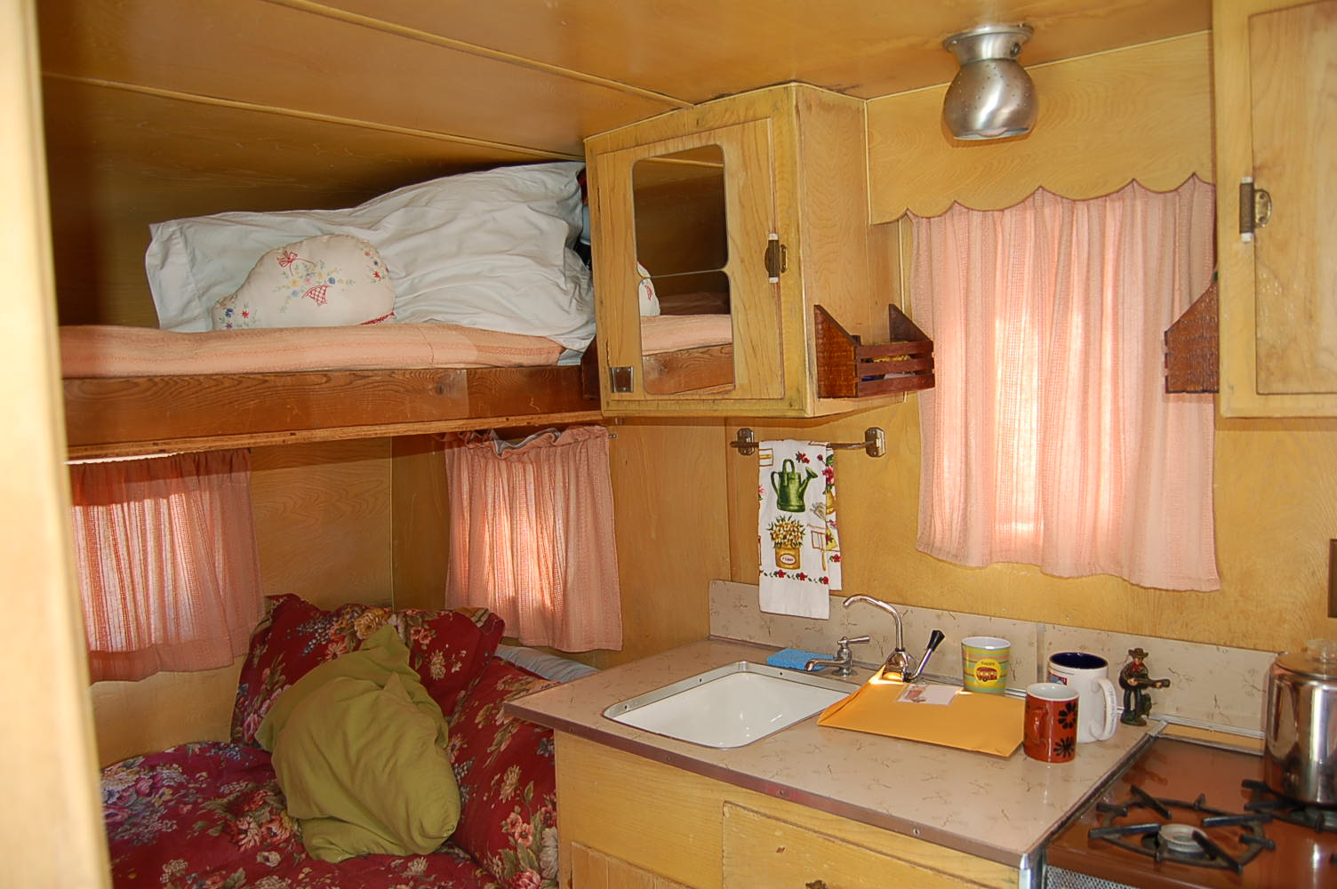Photo Of Warm And Cozy Kitchen And Sleeping Area In A Vintage Aloha Travel  Trailer