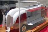 This scale model of one of GM's Parade of Progress buses shows how the sides opened up so the public could see the exciting exhibits displayed inside