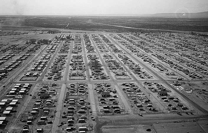 Government photo shows an aerial view of the Hanford trailer camp and the worker housing area for Project Hanford in the state of Washington