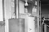 Government photo shows the interior in a 1940's model canned ham trailer supplied by the Government, at Project Hanford Trailer City in Washington