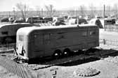 Old photo shows a group of Vintage Trailers that housed workers and their families, at the Hanford Trailer Camp